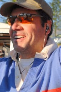Hot air balloon pilot wearing a hat and sunglasses