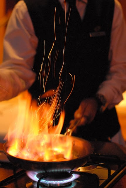 Chef cooking Bananas Foster with high flames