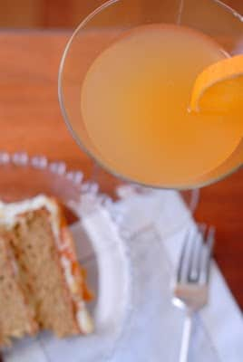 slice of cake with cocktail