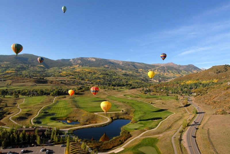 A group of people flying balloons