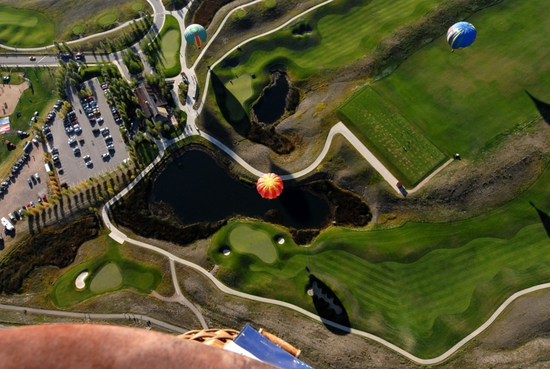 Looking down on hot air balloons
