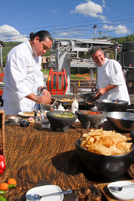 chefs preparing food in a parking lot