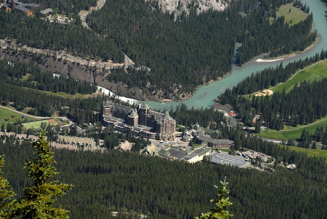 View down on Banff Fairmont hotel from mountains above