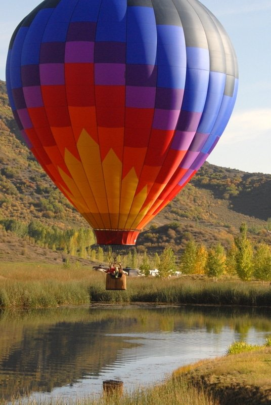 A large colorful balloon in the sky