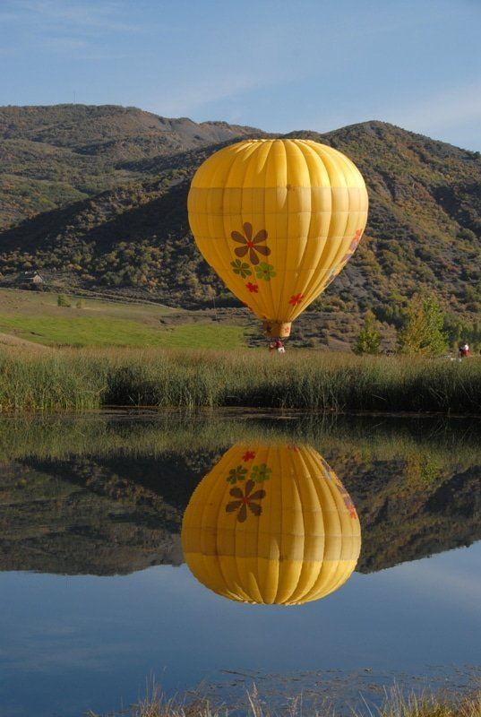 A large yellow balloon in the sky