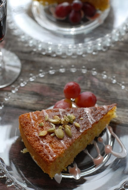 A piece of cake on a plate with grapes