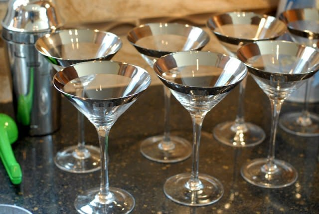 A table filled with cocktail glasses