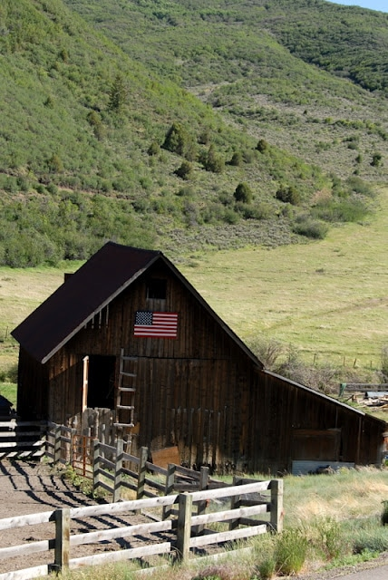 A barn with American flag