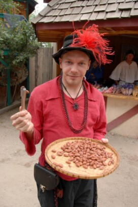Renaissance festival player with food