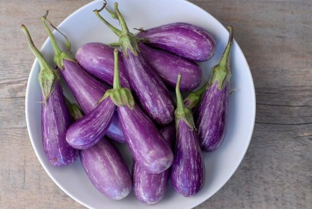 fairytale eggplant in white bowl