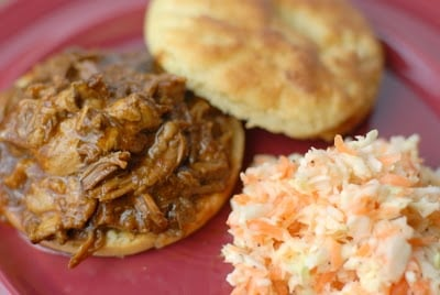 A plate of food, with Cabbage and Pulled pork