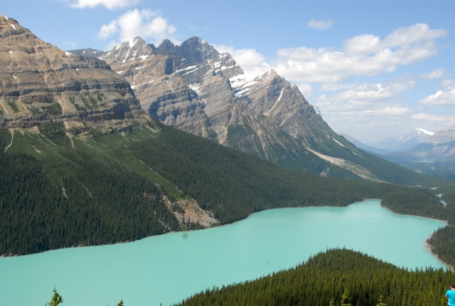 A view of a snow covered mountain with Peyto Lake in the background