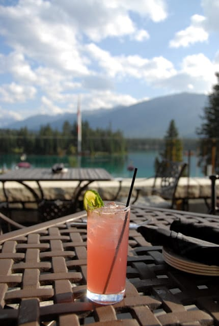 Pomegranate Cucumber Mojito on outdoor table by water Jasper Fairmont