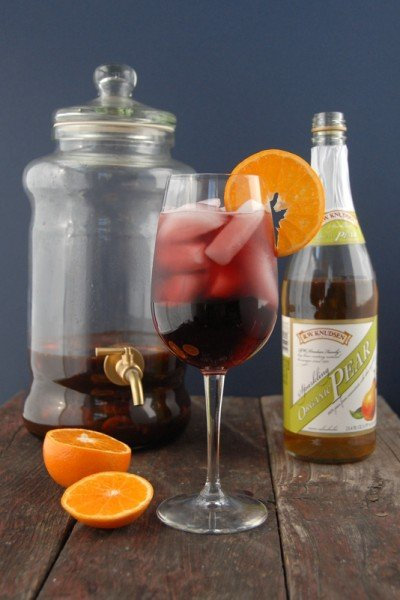 A bottle of wine and a glass of Sangria and Fruit