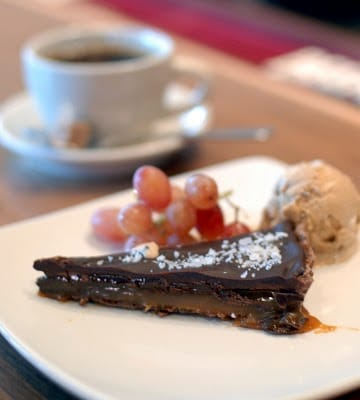 A piece of chocolate cake on a plate, with Tart