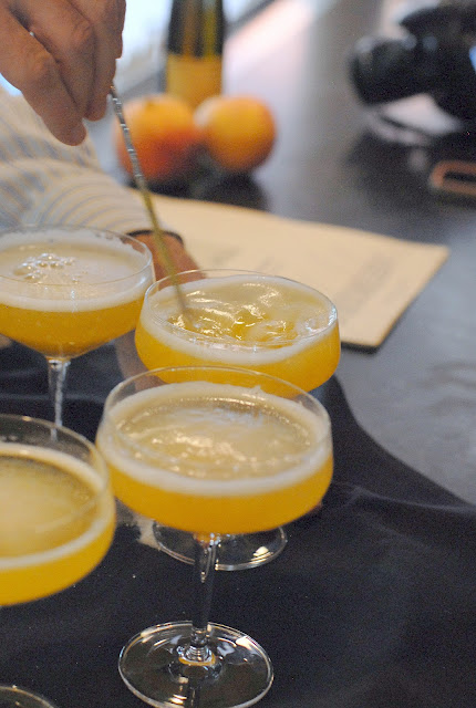 Cocktail glasses of peach bellinis