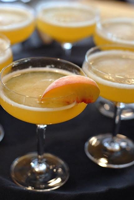 Peach bellinis with peach wedge