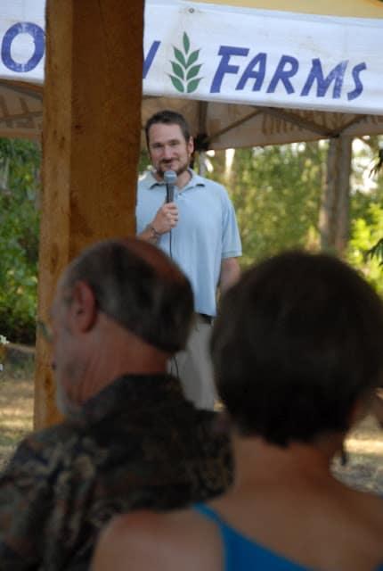 Mark Ollin speaking at farm dinner with Ollin Farms