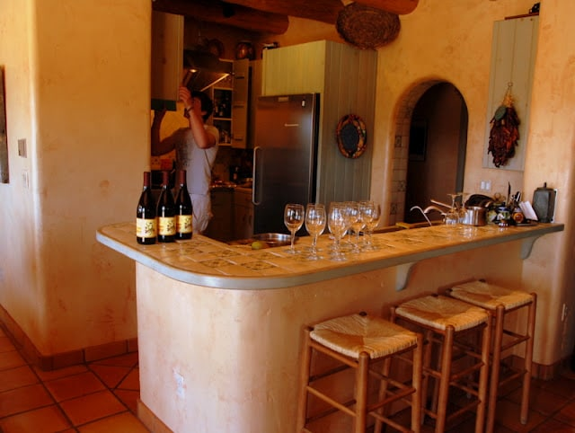Wine bottles and glasses on counter top