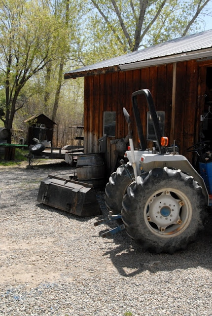 A tractor parked in front of a house