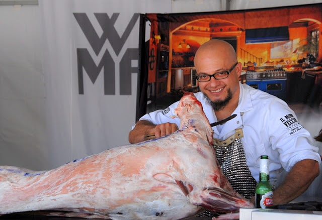 A man carving meat