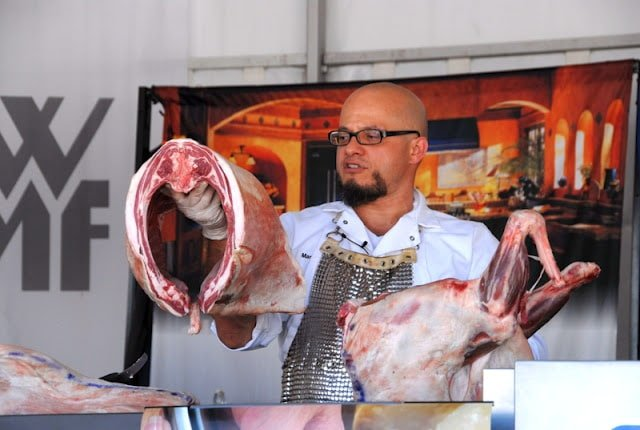 chef demonstrating meat carving butchery