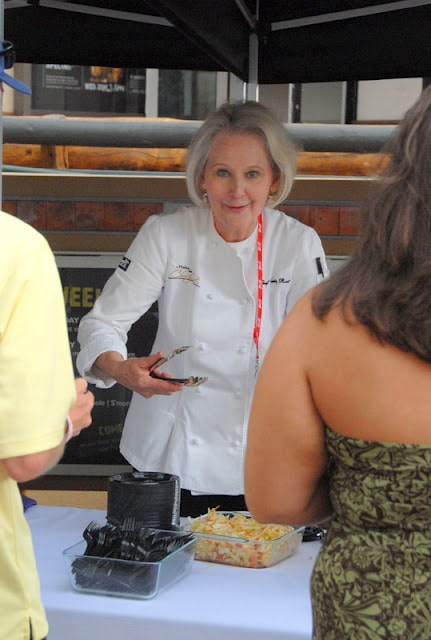 Christy Rost preparing food in a restaurant at Snowmass Culinary festival