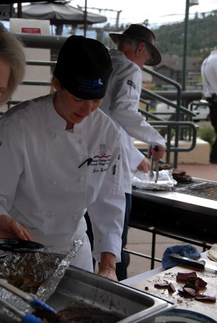 A group of people preparing food inside of it, with Chef and Art