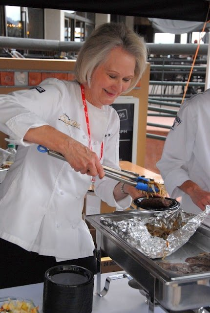 Christy Rost cooking in a kitchen preparing food