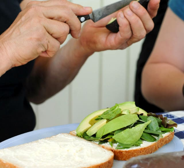 cutting avocado for sandwich