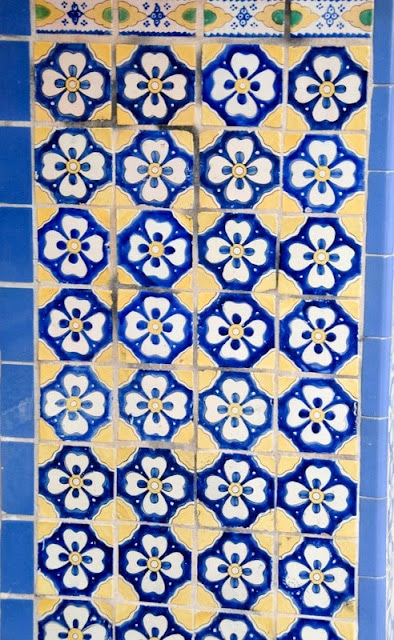 A blue tile wall
