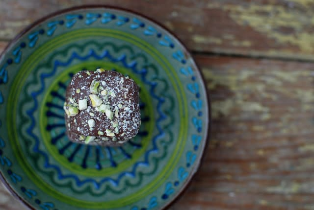 A blue plate, with Pistachio candy