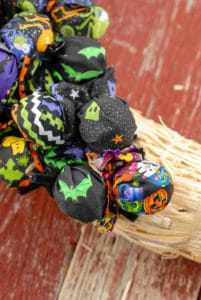 Halloween Trick or Treat inserting lollipops in wreath 2