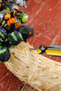 Halloween Trick or Treat inserting lollipops in wreath