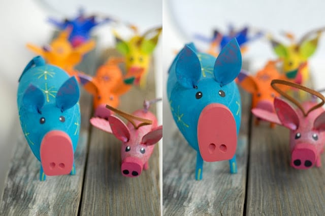 A close up of a wooden painted pigs