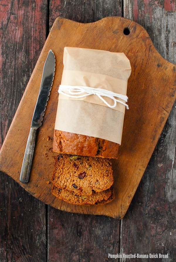 Pumpkin Roasted-Banana Quick Bread. Bursting with fall spices, pumpkin, apple cider and cranberries, this quick bread is a seasonal bread all will love. Gluten-free and gluten options. - BoulderLocavore.com