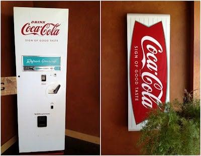A close up of a sign Coke machine