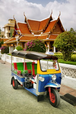 tuktuk parked in front of a house