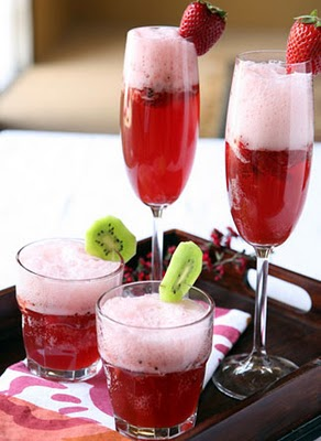 A glass of wine, with Strawberry and Champagne