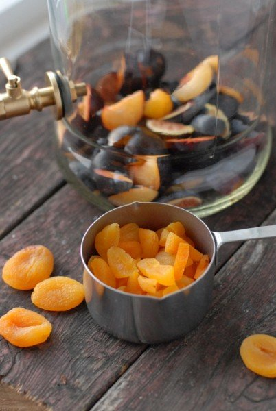 measuring cup of dried apricots