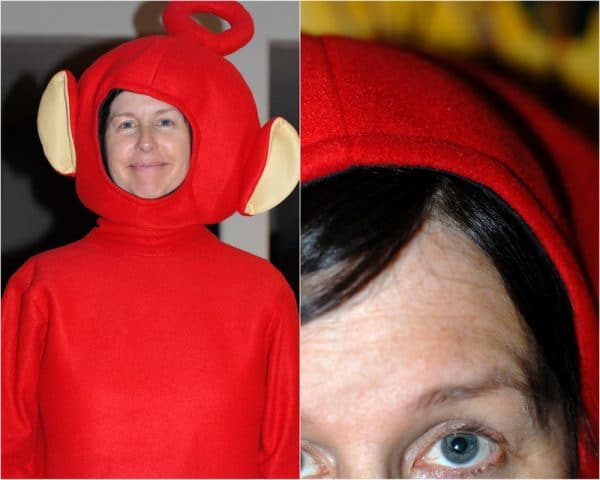 A person wearing teletubby costume