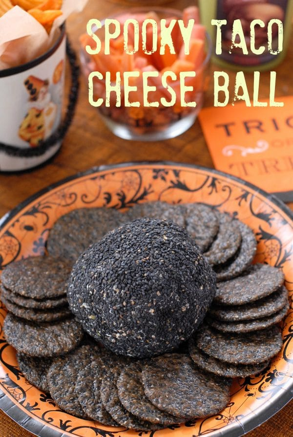 Spooky Taco Cheese Ball. A delicious Mexican-flavored cheese ball appetizer recipe covered with black sesame seeds! Gluten-free. BoulderLocavore.com