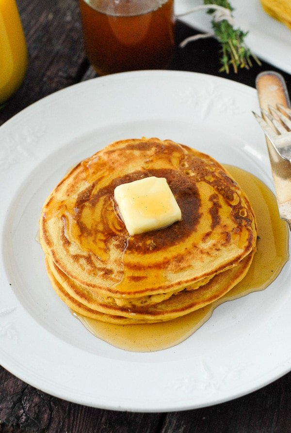 stack of pumpkin pancakes with butter and homemade pancakes syrup