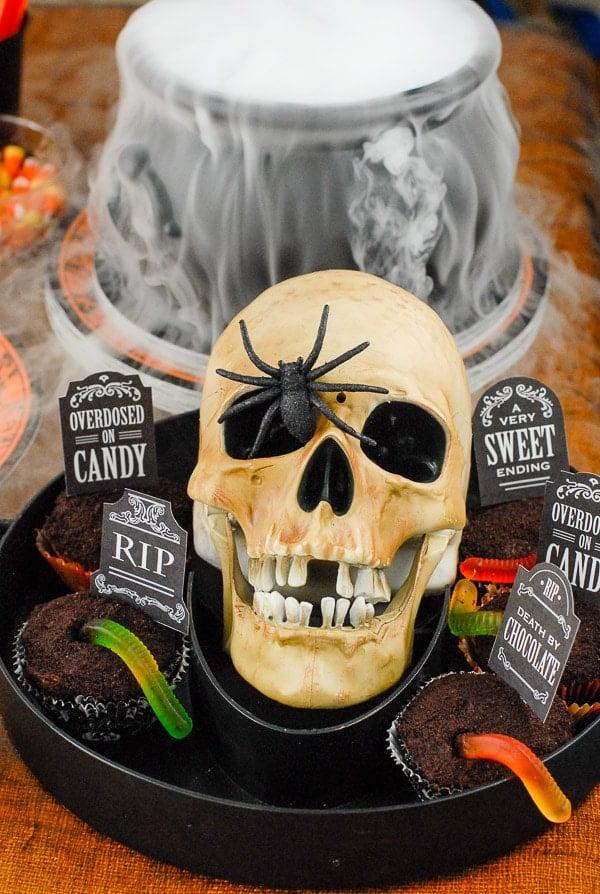 skeleton platter with Halloween cupcakes