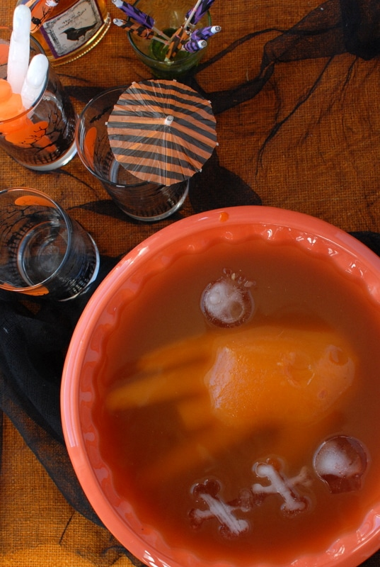 Off With Your Hand Halloween Punch. A delicious seasonal punch with a frozen juice 'hand' floating in it to stay cold. A perfect Halloween sipper! | BoulderLocavore.com