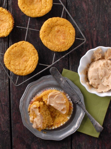 pumpkin cornbread muffins with whipped honey-maple cinnamon butter With knife