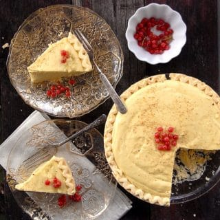 Eggnog Pie sliced on plates and in pie pan