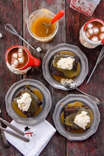 plates of gingerbread cake with butter rum toffee sauce and whipped cream
