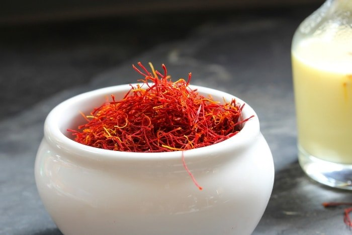 saffron threads in white bowl