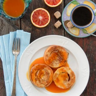 Cinnamon Roll French Toast with Satsuma-Vanilla Syrup on a white plate